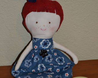 Doll with blue skirt