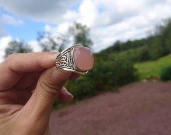 Rose quartz mounted on silver ring