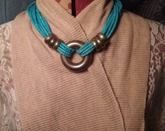 Strands of Wooden Turquoise Color Beading Featuring Copper Rings and Circular Copper Center