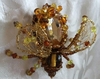Handmade Gold beetle brooch with transparent wings of beads