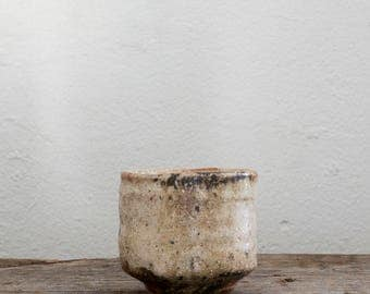 Handmade ceramic yunomi, rustic woodfired cup with shino glaze and natural ash glaze for tea, water