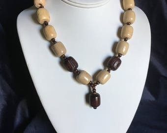 Large wooden bead necklace.