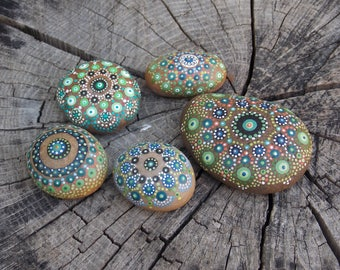 five assorted painted pebbles