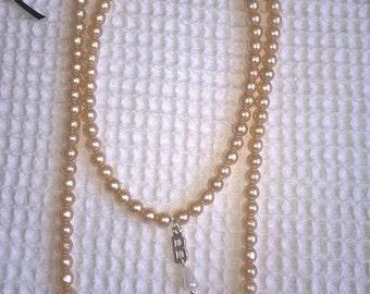 Anne Boleyn style necklace.