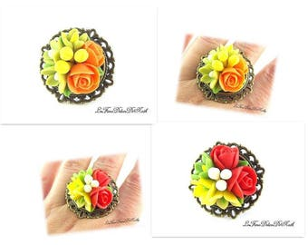 Ring orange or red and yellow flowers cold china in the choice