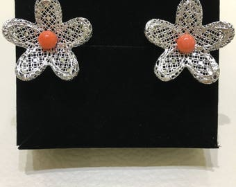 Silver filigree flowers with a bullet in coral
