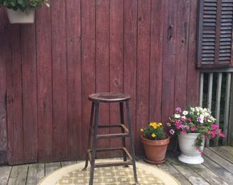Black Metal Vintage Stool with a rustic industrial style