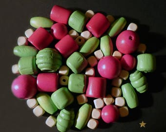 Wooden beads of various shapes of beige, green, pink