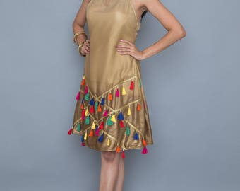 Indian inspired shift dress with colorful tassle trims