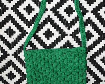 Green hand knitted handbag