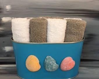 Blue Bathroom Bin - Bathroom Wash Cloth  BIn with Seashells. 6 light gray and 6 white wash cloths.