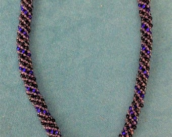 Blue rope and pendant beaded necklace
