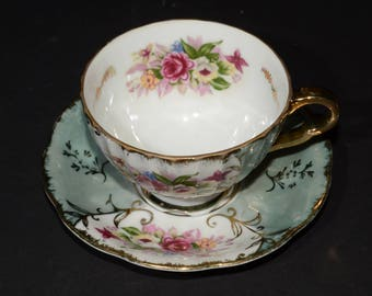 Vintage, White Colored, Iridescent, Made in Japan, Teacup and Saucer Set, Pink and yellow roses, lovely green, gold filigree, Lusterware