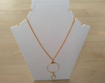 Gold metal and gemstone necklace.