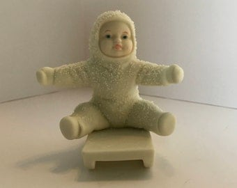 Snowbabies department 56 Give Me A Push. Porcelain figures