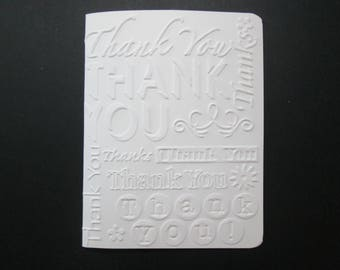 An Embossed Thank You Card with Envelope