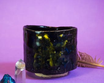 A- Mysterious black stoneware bowl with cobalt blue shades and yellow spots