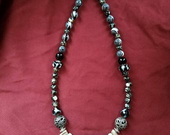 The Dark Bite Black and White Faux Teeth Necklace