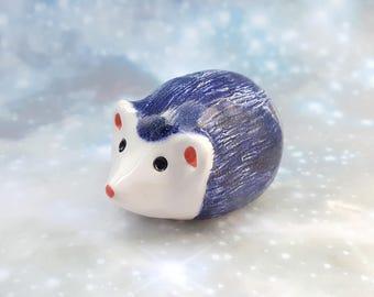 One Ceramic Hedgehog Figurine with Sparkly Blue Glaze
