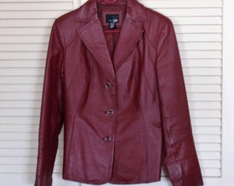 Vintage Leather Jacket, gently used.Warm Rich Wine color. Very good condition .Genuine Leather.All Tags intact.Estate purchase. medium size