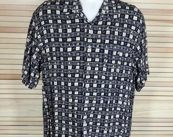 Vintage Hawaiian tiki print rayon shirt Pierre Cardin size L large chest 46