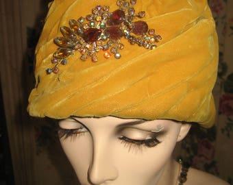 """1960's, 22"""" inside hat, mustard colored pleated velvet pill box hat."""
