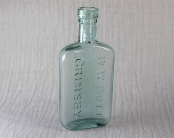 Small Vintage Spirit Bottle W.W. Butt Grimsby Blue Tinted Clear Glass
