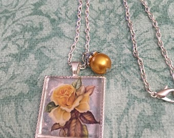 Yellow rose image on a bluish background one inch square cabochon pendant necklace  item #115