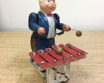 Vintage wind up toy. Wonderful Celluloid/Tin Xylophone Player. Made in Occupied Japan.