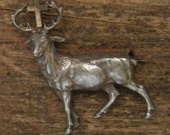 Antique silvered brooch of the holy deer with cross of Saint Hubert