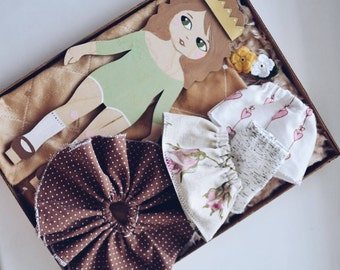Wooden doll with clothes