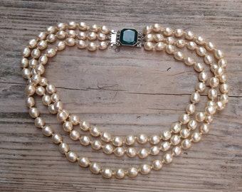 Vintage three strand glass Pearl necklace with green rhinestone clasp