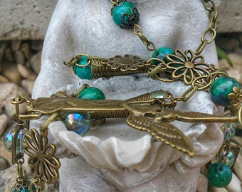 Aqua aura, Angel theme, and chrysocolla necklace bronze color.