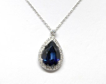 Pear Blue Sapphire and Diamond Halo Pendant in 18k white gold with chain