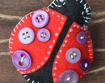 An Adorable Ladybug Brooch Handmade with Felt, Beads and Buttons.