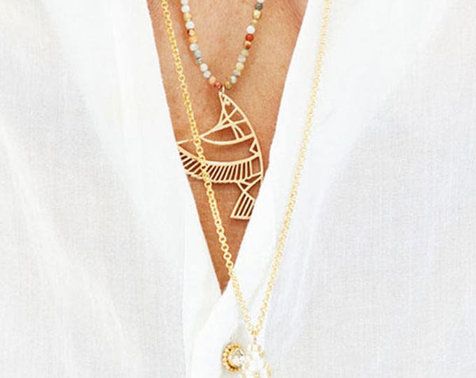 with an Indian pearls pendant necklace