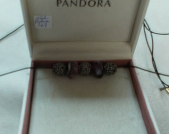 Pandora.  Three sterling and two stone beads.  (769)
