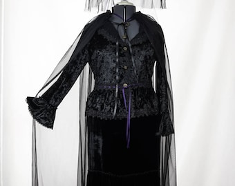 Victorian Velvet Witch trimmed in purple ribbon