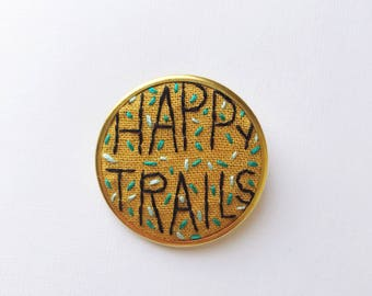Happy Trails • Hand Embroidered Pin in Gold • Gift idea for hikers outdoor enthusiasts • Adventure Pin • Wearable Embroidery