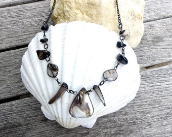 Mother of the island of Reunion and Obsidian necklace