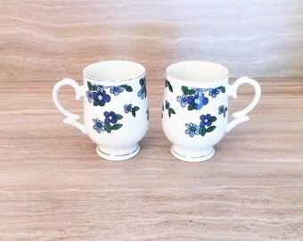 Mod Blue Flower Pedestal mugs, Translucent Porcelain, Royalton china co. Japan