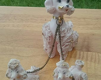 Kitschy pinkish china poodles from yesteryear, Mama dog, two puppies on chain, vintage porcelain