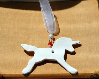 Unicorn Pottery Pottery Ornament, with a lovely white glaze. Handmade pottery sent in a lovely gossamer bag ready to be given as a gift.