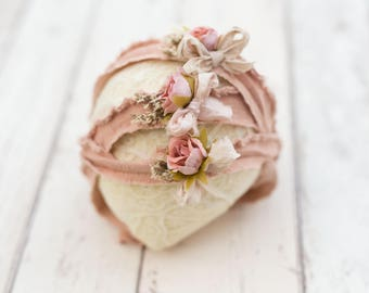 Dusty peachy blush newborn headband prop with natural dried flowers.