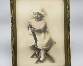 Vintage Framed Sepia Photo of Smiling Child with Hat Posing on Chair