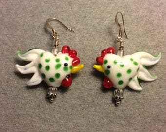 White with green spots heart shaped lampwork rooster bead earrings adorned with clear Czech glass beads.