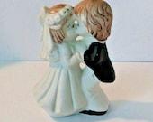 Vintage Bride and Groom Kissing ceramic figurine, distressed bride and groom, 1960s