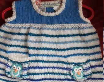 Hand knitted dress to fit a baby gireally aged 3-6 months old