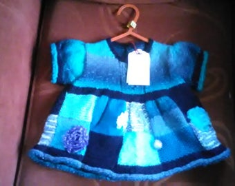 Hand knitted dress to fit a a little girl aged 6-12 months old