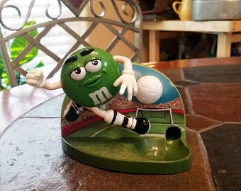 Green M&M soccer player candy dispenser